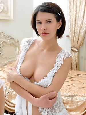 """A modern, elegant bedroom makes a perfect setting for Suzanna's subtly erotic allure, and mellow but confident personality."""