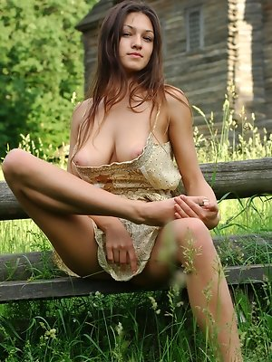 """Sofi A teases her amazing breasts out of her little dress in a field of beautiful green grass. """