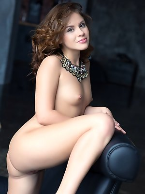 Beautiful Leda displays her gorgeous physique then spreads her sexy legs wide open baring her unshaven pussy on the chair.
