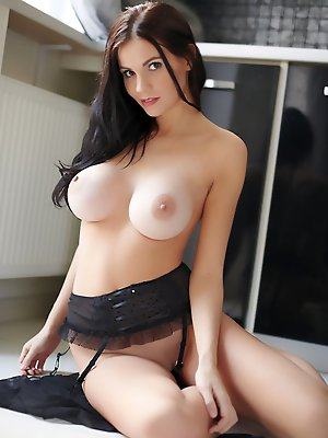 Large, lovely tits and an oh-so-yummy pussy, Eliana teases the camera all for you.
