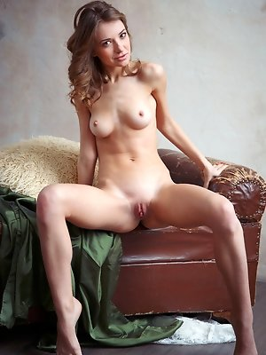 Yani A flaunts her lean and petite body with ever-erect nipples as she poses sensually on the couch.