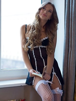 Amy Moore showcases her stunning body and delectably pussy by the window.